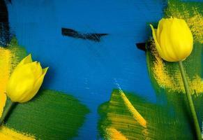 Yellow tulips with eucalyptus leaves