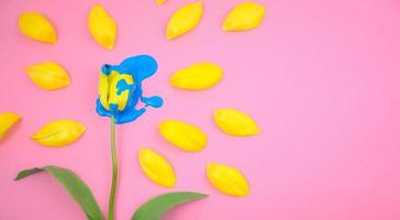 Acrylic dripping on yellow tulip flower