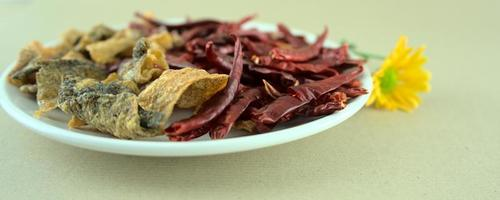 Crispy salted fish skins with dried red hot chilis