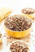 Raw brown rice in wooden bowl