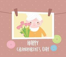 feliz día de los abuelos, foto colgante con abuela sosteniendo flores tarjeta de dibujos animados