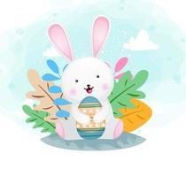 Lindo conejito sonriente feliz abrazando el huevo de pascua vector