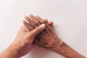 Young person holding an old person's hand photo