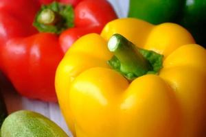 Yellow orange and red bell peppers photo
