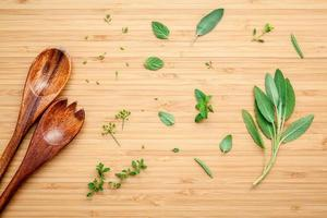 Herbs and wooden utensils photo