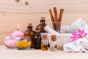 Aromatherapy and natural spa theme on wooden background photo