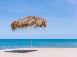 Straw umbrella on a beach