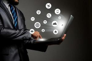 Young businessman with multimedia network icon graphics photo