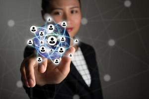 Business woman touching modern technology interface with 3D icons