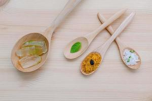 Organic skincare items in spoons