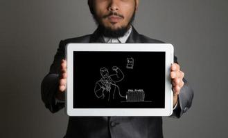 Businessman holding tablet pc with business doodle icon