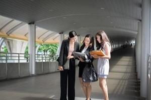 Businesswomen discussing work together photo