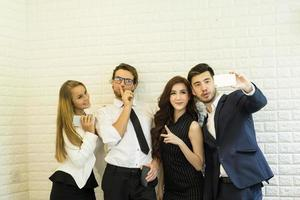 Business people taking selfie while working at office photo
