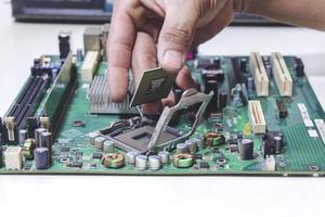 Technician hand holding the CPU for fixing and upgrade computer pc to repair