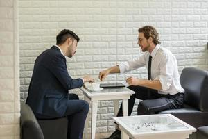 Young businessman talking with colleague in a modern business lounge photo