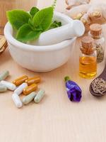 Herbs with alternative medicine photo