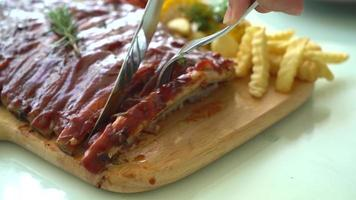 Grilled rib pork with barbecue sauce and vegetable and French fries