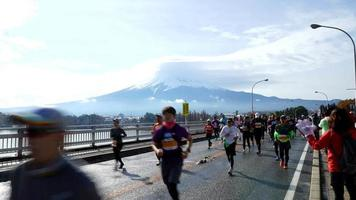 Timelapse crowd people running marathon with Mountain Fuji background