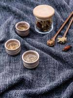 Chrysanthemum tea on cloth photo