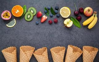 Fruit and waffle cones on a gray background