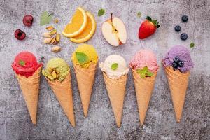 Fruit-flavored ice cream on concrete photo