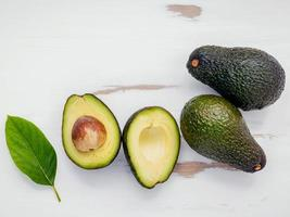 Top view of whole and halved avocados