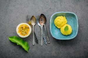 Passion fruit ice cream in a blue dish
