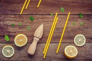 Fresh lemons and straws