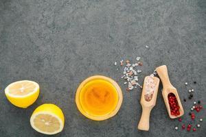 Lemon vinaigrette dressing ingredients with copy space photo