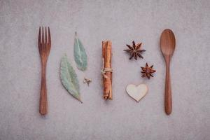 Wooden utensils with herbs and spices photo