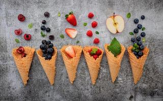 Flat lay of fruit and waffle cones