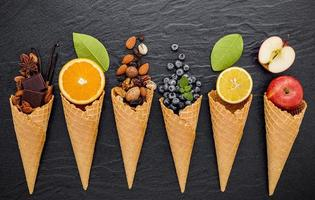 Top view of waffle cones with fruit and nuts