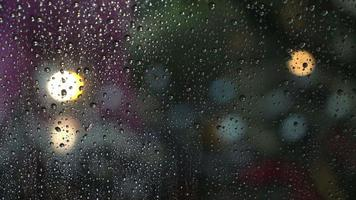 Raindrops on a window with bokeh light