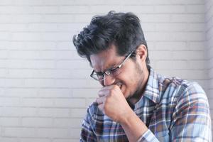 Asian man coughing photo