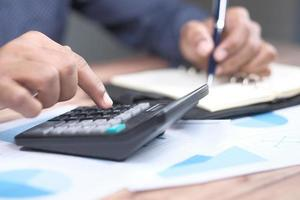 Close up of accountant using a calculator photo