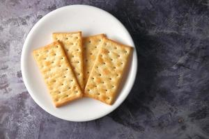 Crackers on a white plate photo