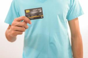 A man holding a credit card