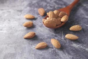 Close up of almond nuts in a spoon photo