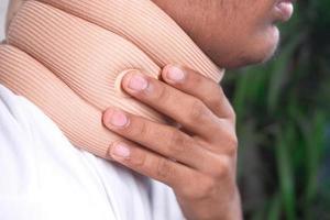 Man wearing a neck brace photo