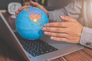 Use a computer to work to make money to communicate around the world photo