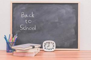 Back to school words written on chalkboard background
