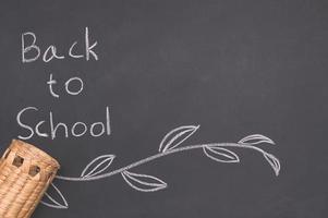 Back to school words written on chalkboard background photo