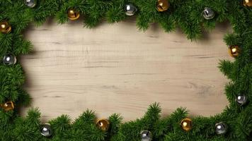 Green spruce pine branches on a wood background frame