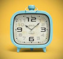 Retro alarm clock isolated on a yellow background in 3D rendering