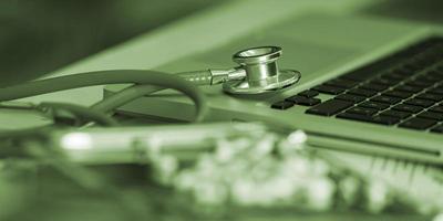 Stethoscope and medicine close-up photo