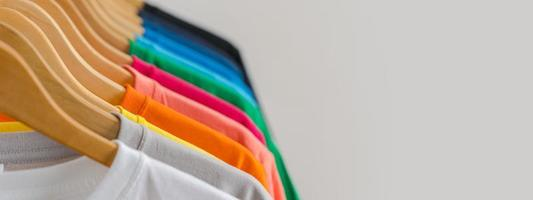 Close up of t-shirts on hangers, apparel background photo