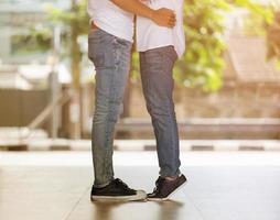 Couple kissing, girl stands on tiptoes to kiss her man