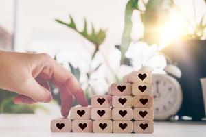 Heart icons on wooden step boards with blank copy space background photo