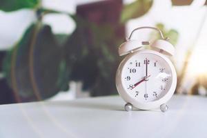 Selective focus of alarm clock showing 8 o'clock photo