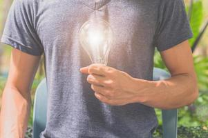Man holding a light bulb photo